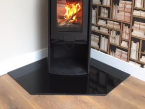 A 20mm Bespoke Corner Hearth in Polished Granite for free standing stove