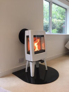 "A ""D"" Shaped Hearth in Smoked Glass for a free standing stove"