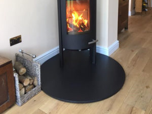 A 20mm Teardrop Hearth in Honed Granite for free standing stove