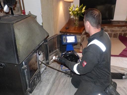 chimney sweep at stove