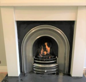 Gas open fire with steel inset and stone mantel