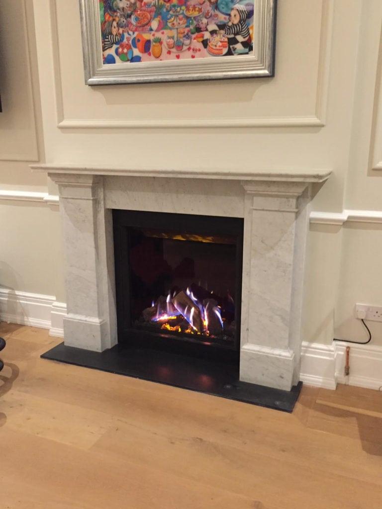Gas open fire stone mantel 2