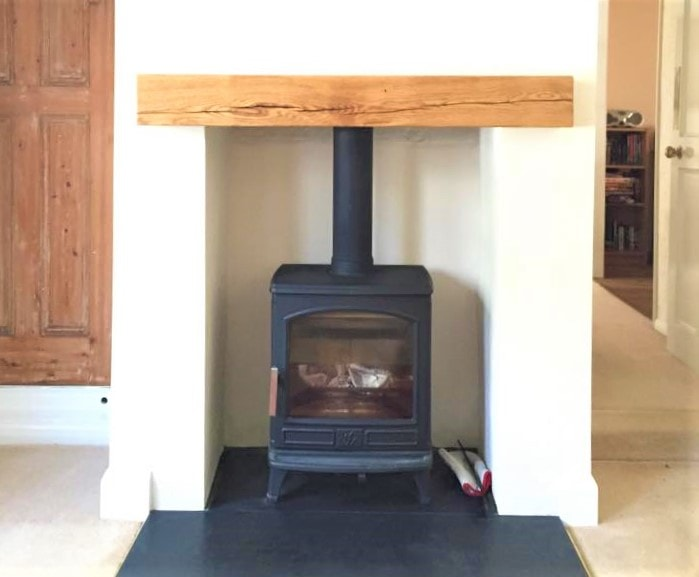 Tradiotional Free-standing stove in beamed opening