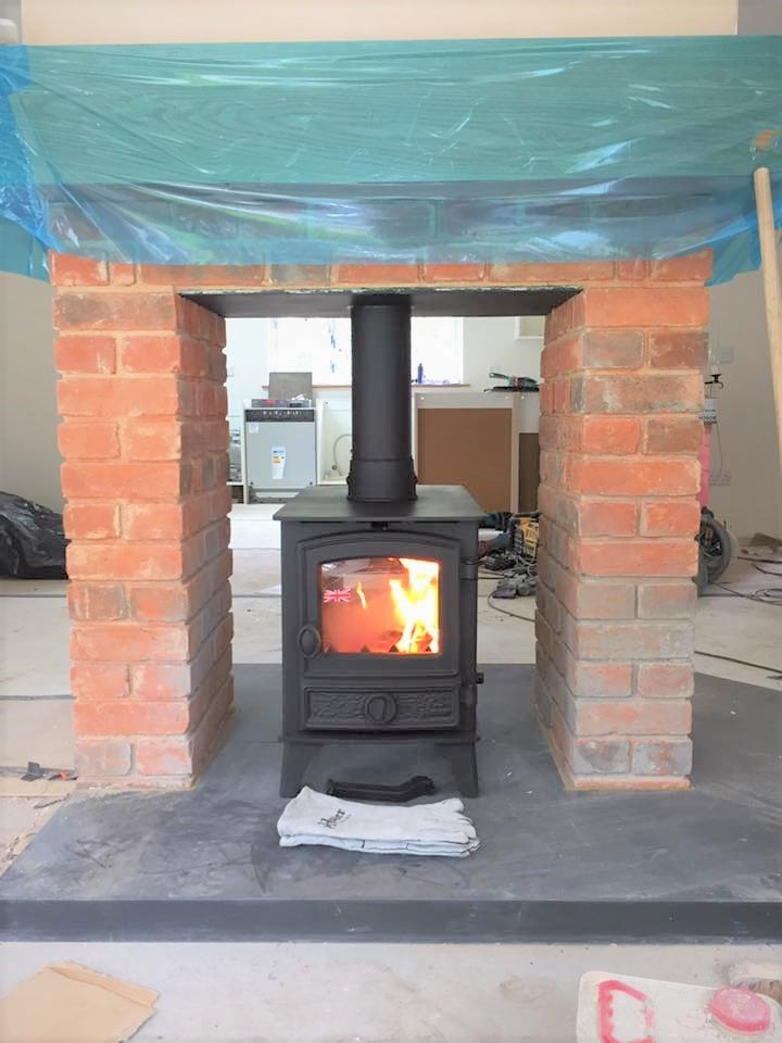 Double sided wood stove